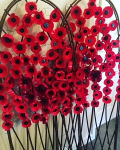 Girls Group Create Poppy Remembrance Arches